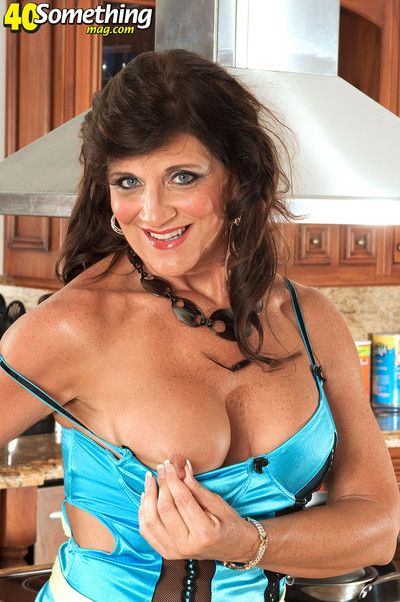Busty housewife playing with her pussy