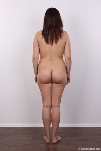 Amateur wife poses for photo camera