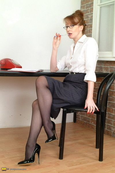 Redhead mature secretary spreading her hot ass in black pantyhos