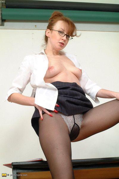 Redhead mature secretary spreading her hot ass in black pantyhos
