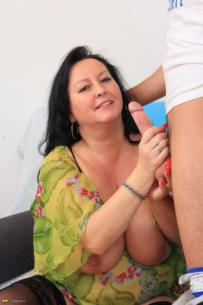 This big breasted mama loves a hard cock
