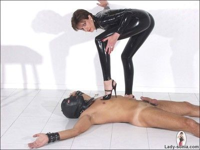 Latex catsuit mistress milf lady sonia trampling her slave