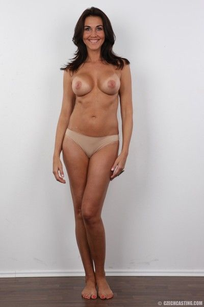 Hot mature brunette poses