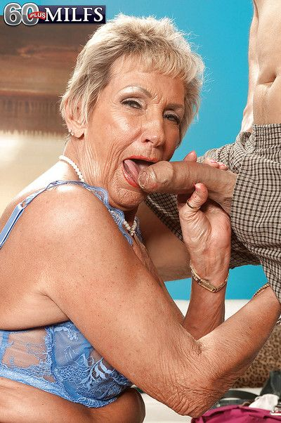 Raunchy granny in nylon pantyhose Sandra Ann giving a delicious blowjob