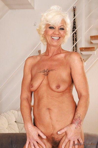 Lusty blonde granny on high heels stripping off her fancy dress