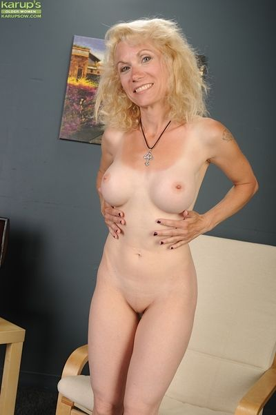 First time older lady Shay Nollen strips off her bra and panties