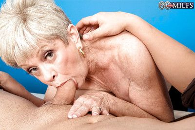 Elegant mature Lin Boyde takes a ride on strong cock of a young dude