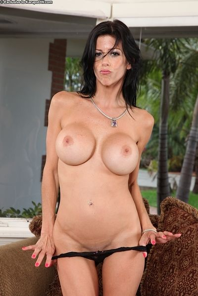 Older brunette model Alexis Fawx baring big fake tits before masturbating