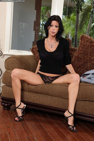 Older brunette model Alexis Fawx baring big fake tits before masturbating