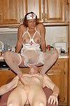Slutty granny nurse Ivee jerking off husband\'s cock in kitchen