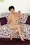 Older woman Karoline fondling all natural tits during masturbation