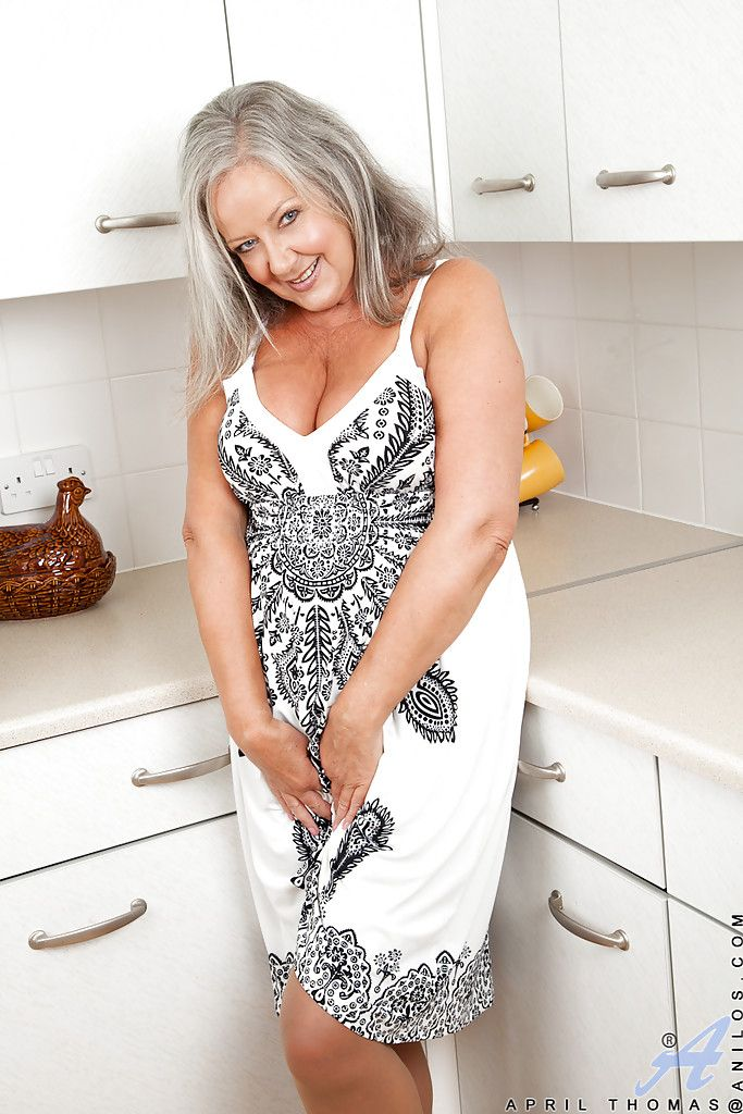 Naughty granny with chubby curves undressing and playing