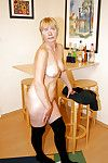 Chubby granny in glasses Sandra AA stripping off her dress and panties