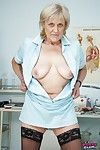 Naughty granny exposing her pink twat and stuffing it with speculum