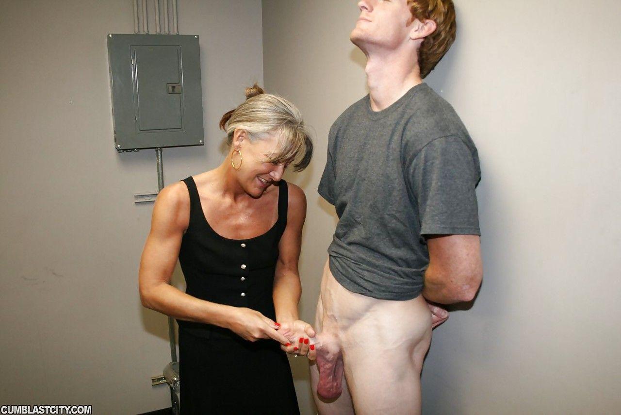 Clothed handjob cumshot