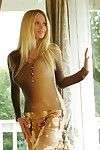 European blonde Victoria Zdrok with long hair and big melons gets naked and opens her legs