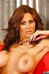 This busty milf Julia Ann is seductively squeezing the big and hot boobs