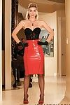 Sexy legged busty Heather Vandeven in red latex skirt and black stockings strips nude