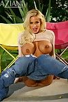 Shyla Stylez in blue jeans shows her shaved snatch then gets her massive tits out