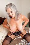 Lusty older bimbo with big tits enjoys fingering her wet pussy