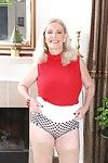 Chubby aged blonde Judy Belkins baring big tits in stockings and high heels