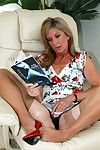 Older woman Satin Jayde inserting pencil into horny pussy in red high heels