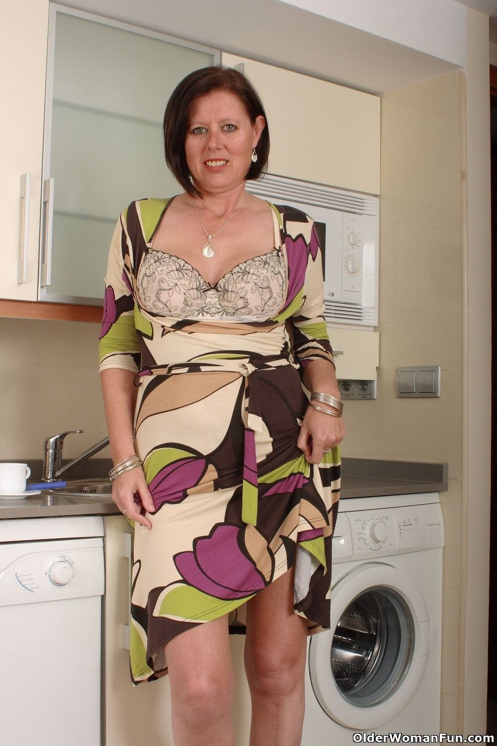 image English milf gilly lowers her knickers