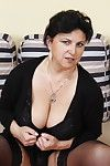 Big breasted mature slut doing two guys at once
