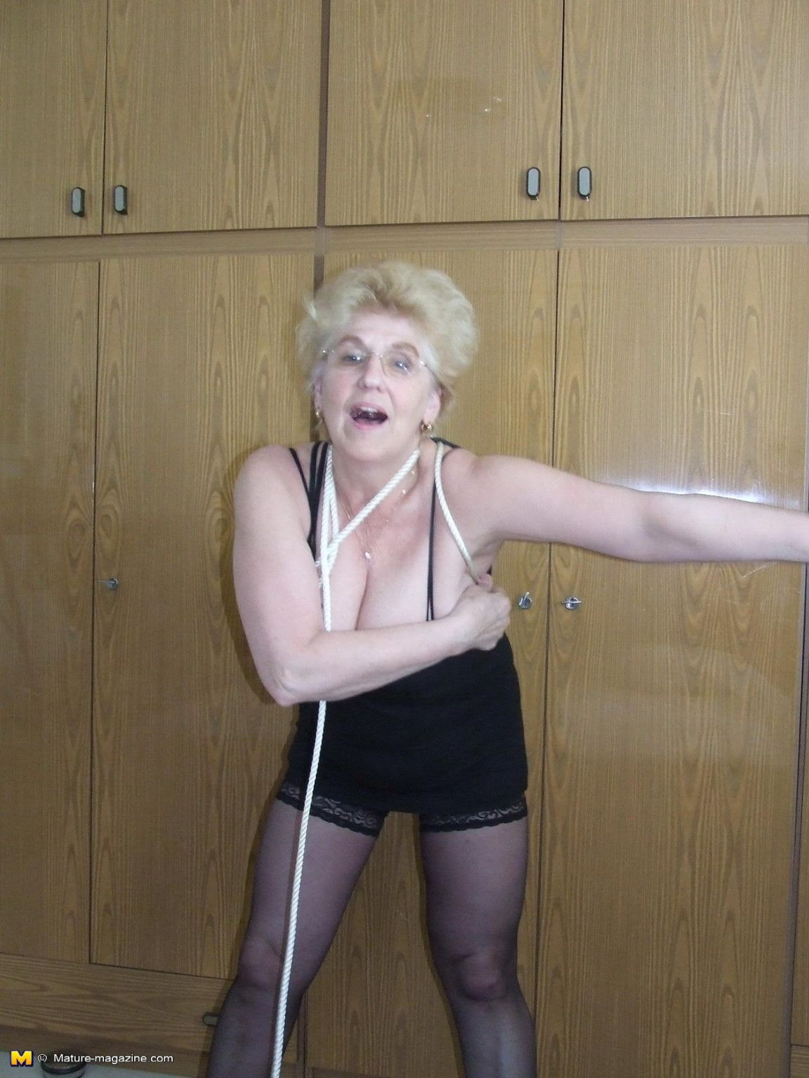 Kinky granny loves to get tied up at Mature Sex Pictures