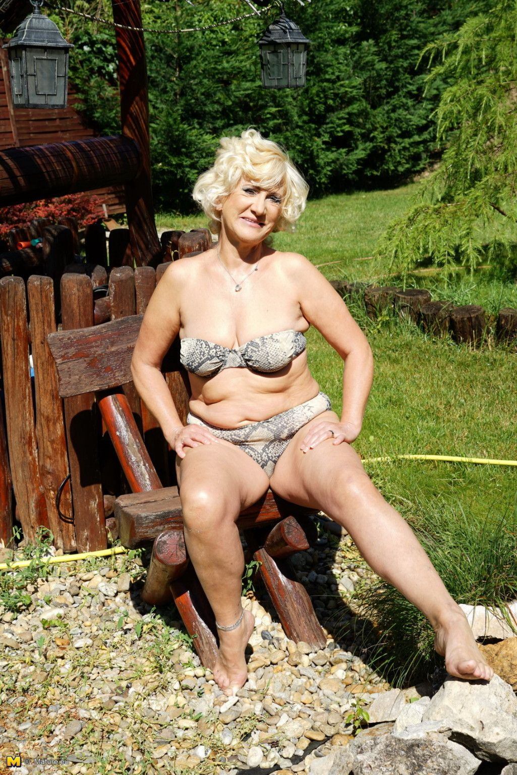 Horny blonde mature woman getting naughty in her garden at ...