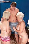 Two horny busty granny sluts sharing a stiff cock