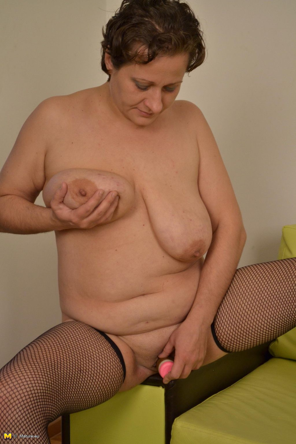 Mature playing in panty