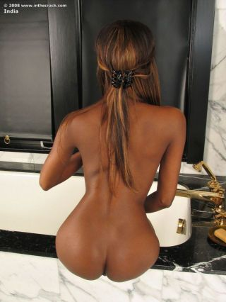 Sizzling ebony pulchritude spreads pussy and ass before showering