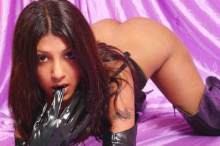 Indian hottie in sexy fetish gear posing