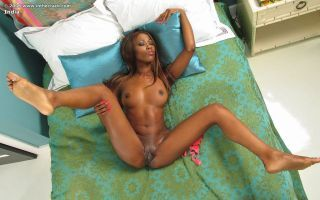 Ebony babe licks the brush panties then spreads and toys